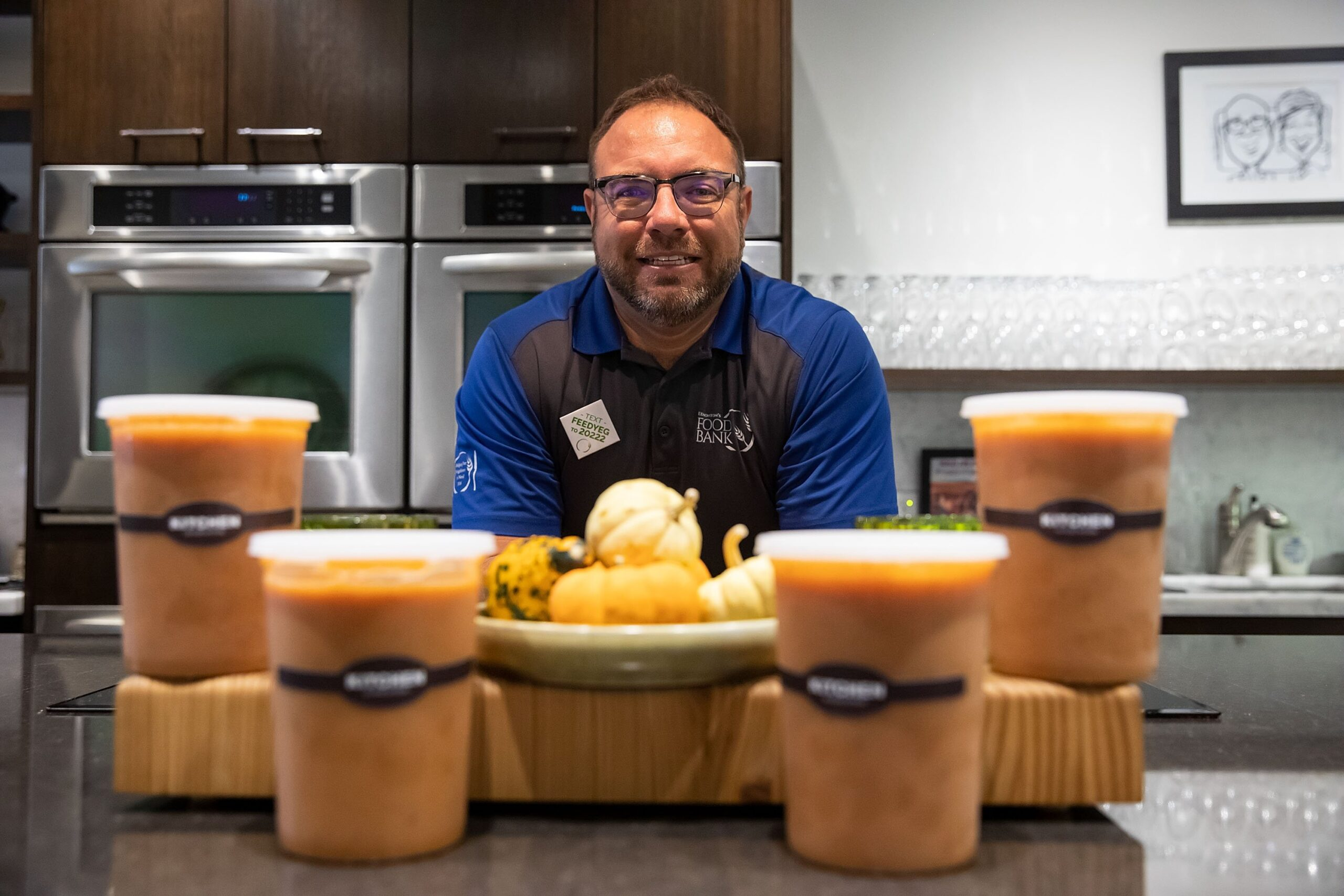 Edmonton Food Bank vice chair David Benjestorf is photographed with soups made from food harvested at his farm at Kitchen By Brad in Edmonton on Friday, Oct. 9, 2020. Benjestorf harvested 95,000 pounds of food this year at his farm, much of which was donated to the Food Bank.